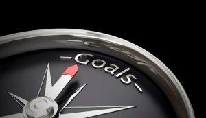Compass facing towards Goals text