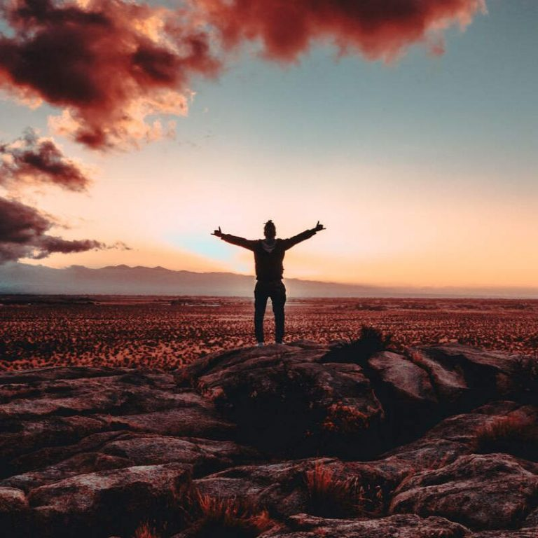 Photo of man standing with arms outstretched