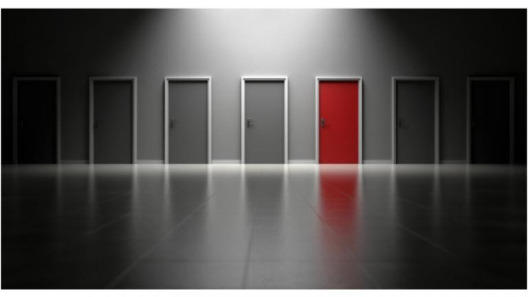 Row of grey doors with one red door