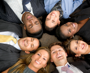 People in suits lying on the floor in a circle