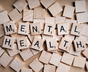 Wooden blocks spelling out Mental Health