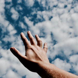 Hand looking up at the sky