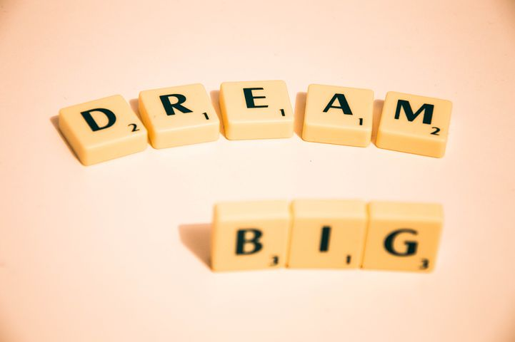 Scrabble tiles spelling out Dream Big
