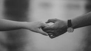 Black and White Photo a 2 people holding hands