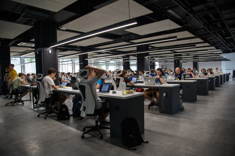 Photo of an office full of workers