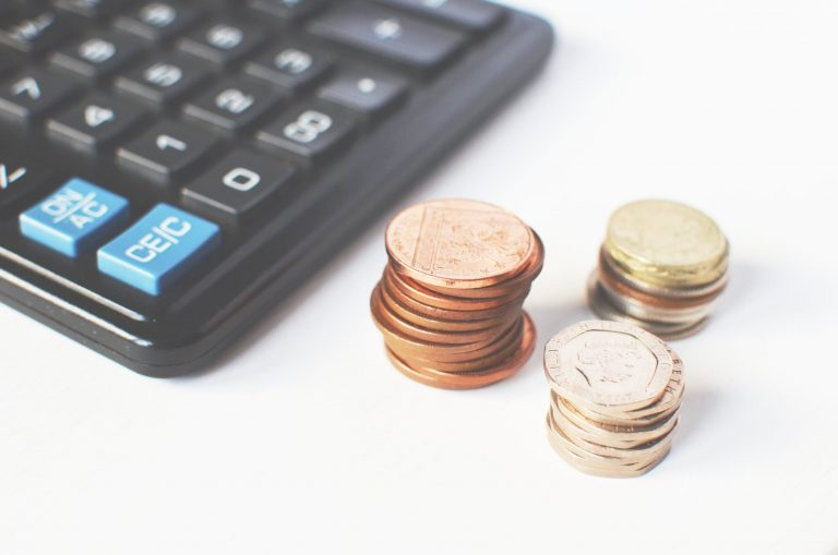 Photo of a calculator and Money