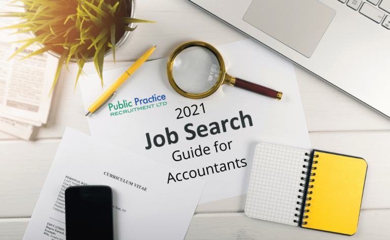 Magnifying glass, paper and pen next to a job search guide for accountants
